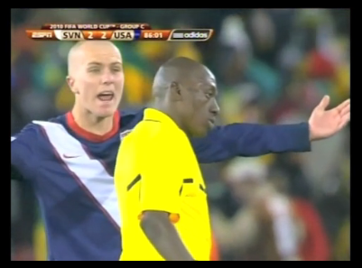 Koman Coulibaly with Michael Bradley World Cup Referee Controversy